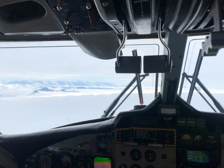Twin Otter throttle controls with Transantarctic Mountains in then background