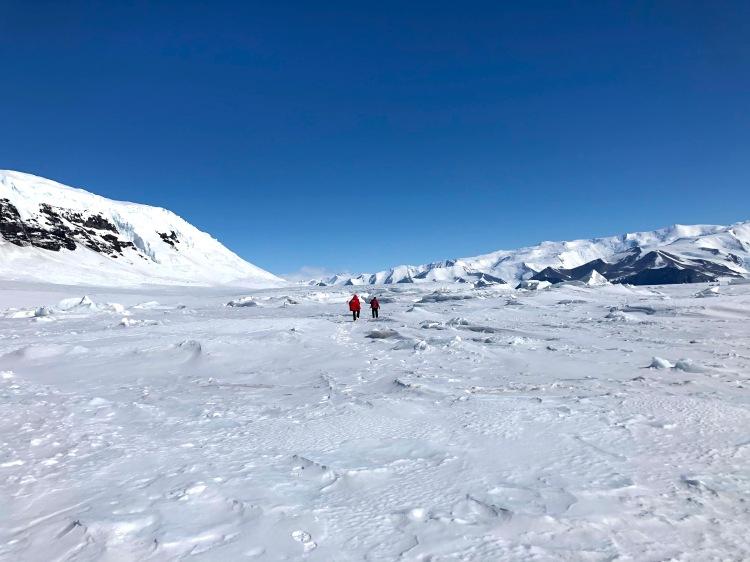 Dr. Scott Landolt & Dr. Mark Seefeldt exploring the ice tundra at Cape Hallett