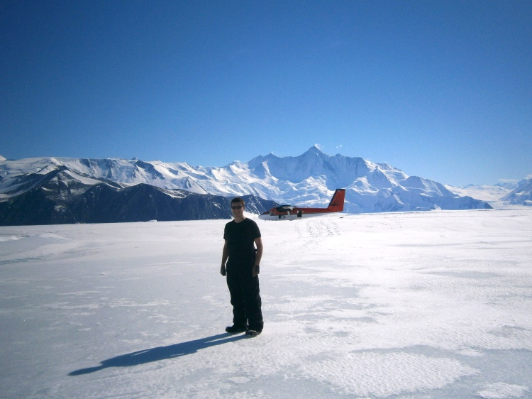 Me with Twin otter and Transantarctic Mountains in the background