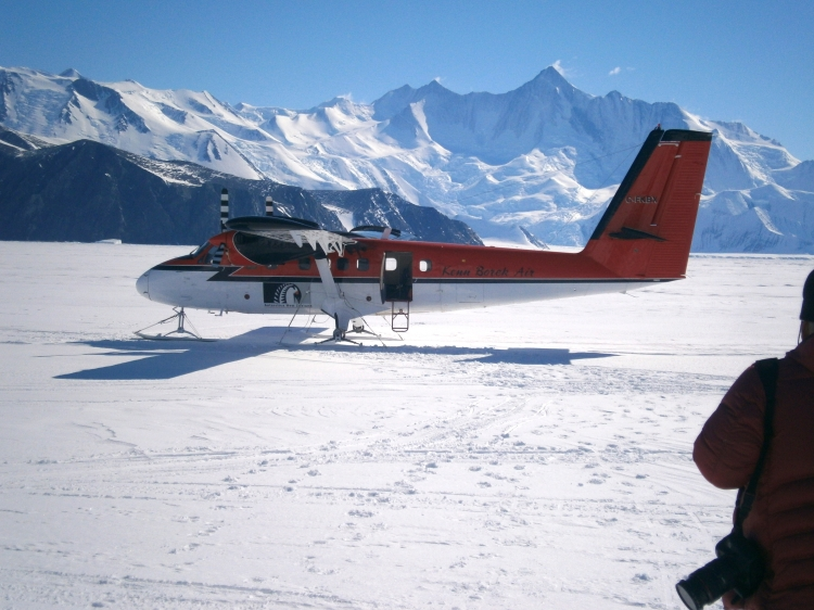 Twin Otter with Transantarctic Mountains in the background