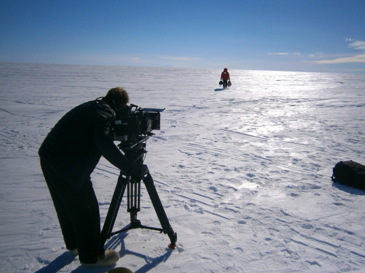 Ollie Filming Lee walking back and forth on the ice sheet