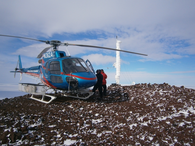 Lee (red jacket) and our pilot Ryan (black coat) near the AStar helicopter at White Island